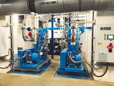 Two piston compressors that are used for air separation.